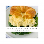 Shows the creamy sour cream and onion egg salad on a croissant with lettuce.